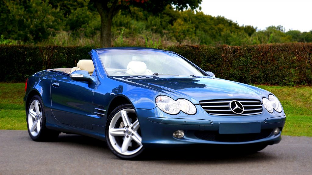 A blue Mercedes convertible