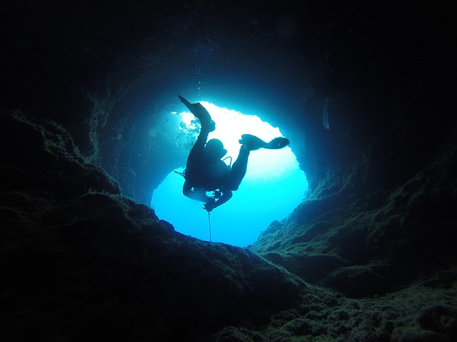 A man diving in a cave.